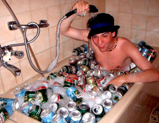 college-drunk-kid-in-bathtub-with-beer-cans
